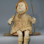 """Little Mary in a Swing"" c. 1969. Paper-Mache, Fabric, Wood, Rope, and Teeth. (27.5"" x 19.5"" x 17"") $750.00"