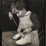 """Young Girl Lacing Shoes"" (Photograph, 18.5"" x 14.5"")"